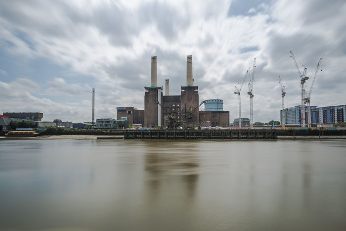 Derelict Battersea power station in London Architecture Batter Battersea Power Station Building Exterior Built Structure City Cloud - Sky Day Derelict Building DISUSED Factory Industry Landscape Nature No People Outdoors Sky Smoke Stack Water Waterfront