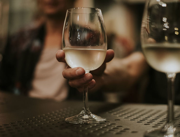 Family Friends Lifestyle Alcohol Drink Focus On Foreground Food And Drink Glass Hand Holding Human Hand Real People Refreshment Socializing Togetherness Wine Wineglass