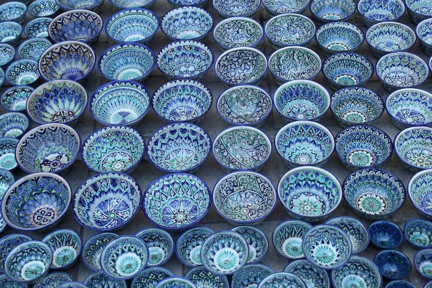 Beauty of blue bowls; every one individually decorated, Bukhara, Uzbekhistan. Blue Bowls Crockery Plates Ceramics Painted Repetition Pattern Patterns Pattern Pieces
