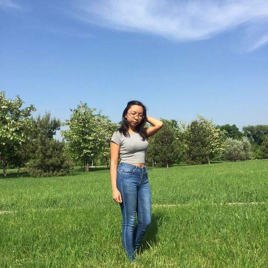 Only Women One Woman Only Women Adult Jeans Casual Clothing One Person Adults Only Females Smiling People Front View Long Hair Tree Summer Cheerful Portrait Outdoors Looking At Camera Nature