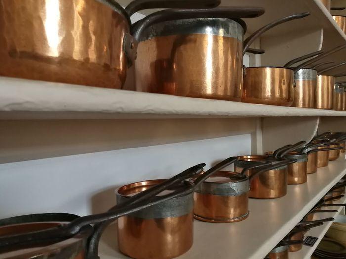 Copper saucepans on a kitchen shelf at Shugborough Copper  Copper Saucepan Shelf Food And Drink Establishment Close-up Cooking Pan Kitchen Saucepan
