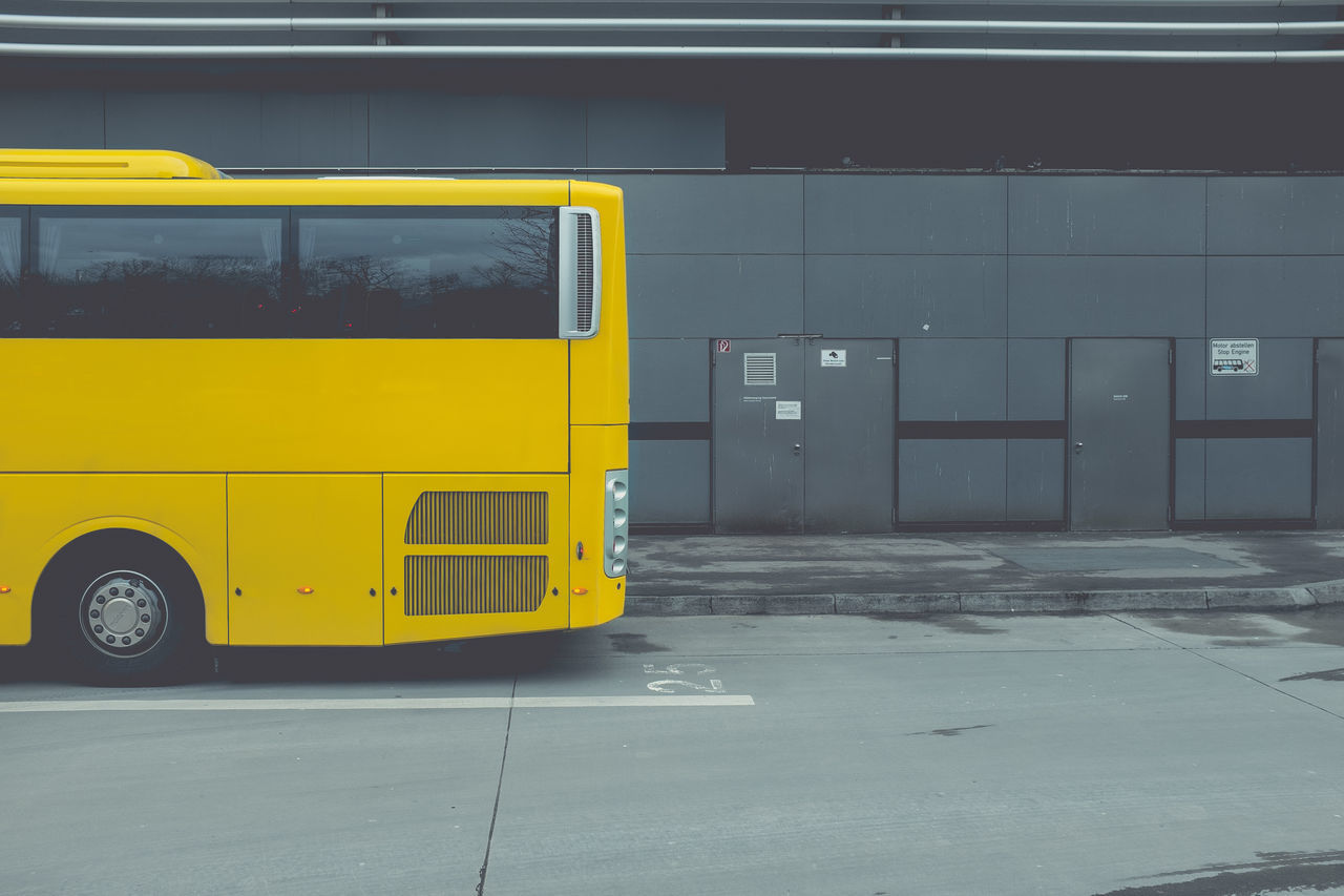 Cropped Image Of Yellow Bus On Street