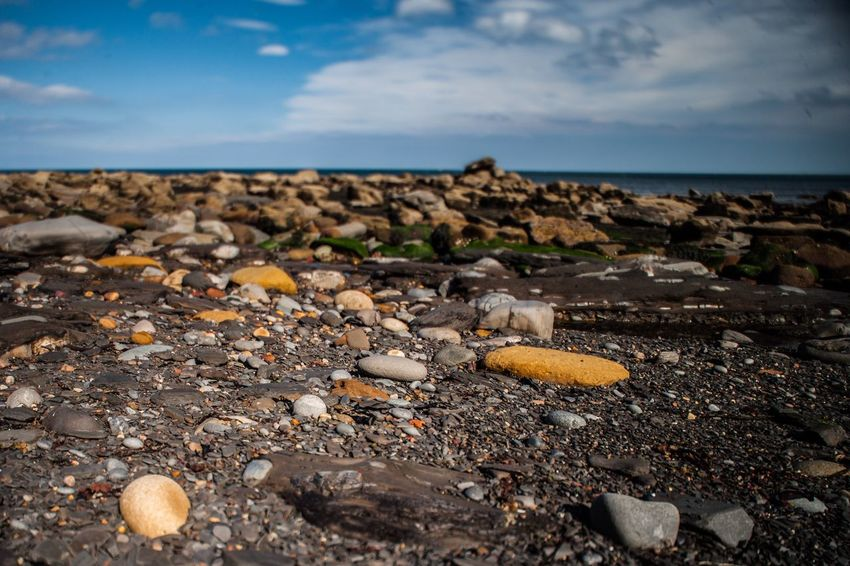 Rock Beach Whitby Seaside Sky Pebble Beach Nature Sea Horizon Over Water Cloud - Sky Tranquility Outdoors Rock - Object Scenics Tranquil Scene No People Water Day Beauty In Nature Close-up