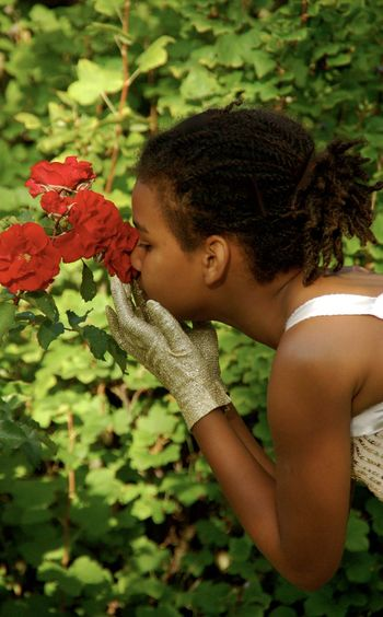 Mixed race girl smelling rose Roses Plant Child Nature Flowering Plant One Person Childhood Flower Side View Innocence Hairstyle Portrait Hair Red Freshness Day Outdoors Garden Photography Garden Flowers Beauty In Nature Beautiful Beautiful Nature Mixed Mixed Girl Mixed Race Mixed Kids