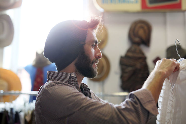 Adults Only Arts Culture And Entertainment Beanie Beard Casual Clothing Close-up Fashion Headshot Indoors  Lifestyles One Man Only One Person Only Men People Stubble Vintage Clothing Store Vintage Shopping Weekend Activities Young Adult