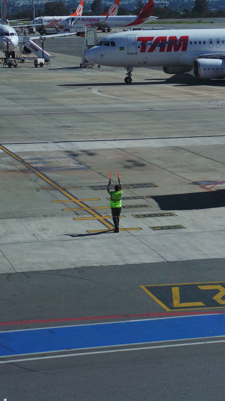 transportation, one person, full length, real people, day, men, outdoors, airport runway, airplane, reflective clothing, adult, people