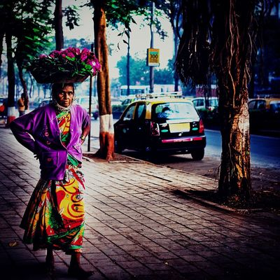 My Year My View Street Looking At Camera Car Portrait Real People Land Vehicle Full Length Outdoors One Person Traditional Clothing Tree Transportation Front View Standing Stationary City Life Cultures Adults Only Sari Adult
