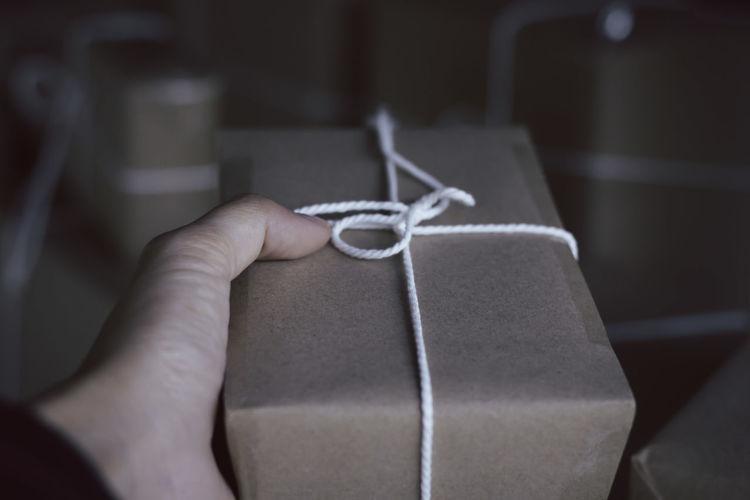 Close-up of human hand holding box