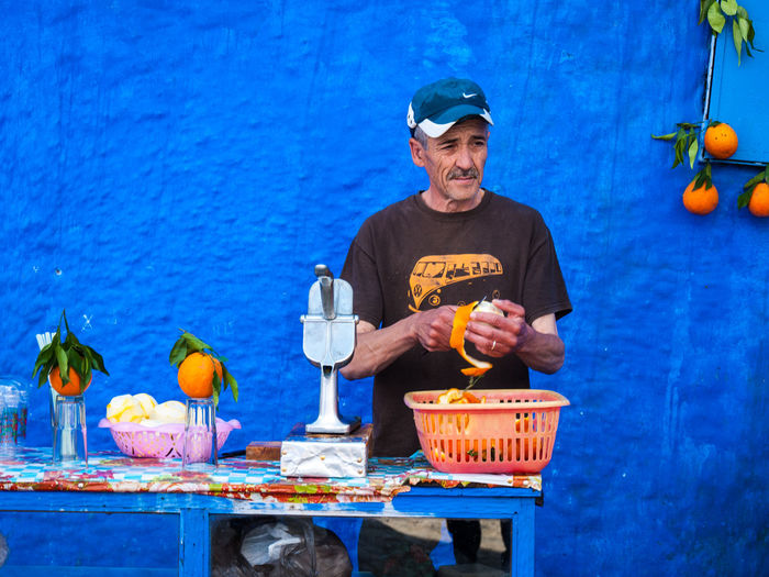 Portrait of man with fruits