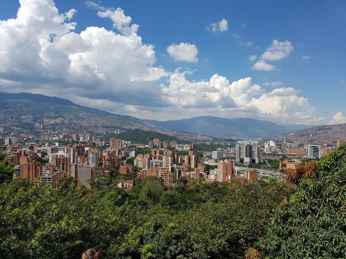 Medellin city view and details Architecture Beauty In Nature Building Building Exterior Built Structure City Cityscape Cloud - Sky Day Environment Green Color Location Mountain Nature No People Outdoors Place Plant Residential District Scenics - Nature Sky TOWNSCAPE Tree