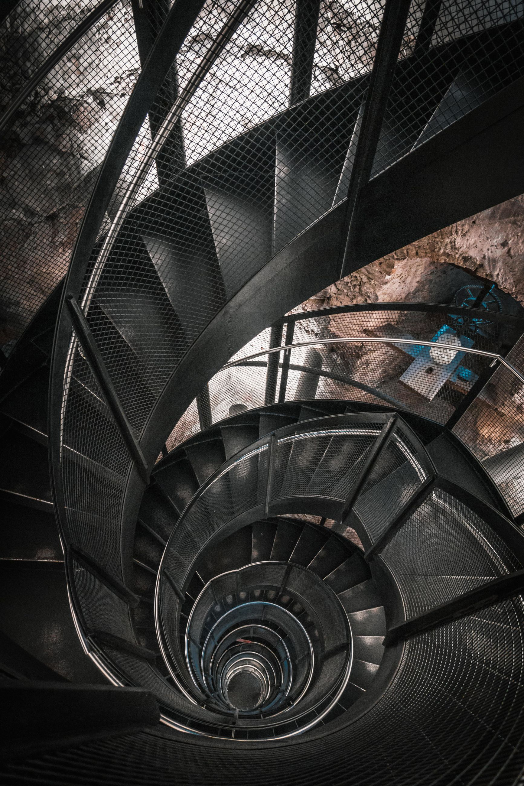 staircase, steps and staircases, architecture, spiral, indoors, built structure, railing, high angle view, metal, no people, spiral staircase, pattern, day, directly above, mode of transportation, transportation, building, travel, car, wheel