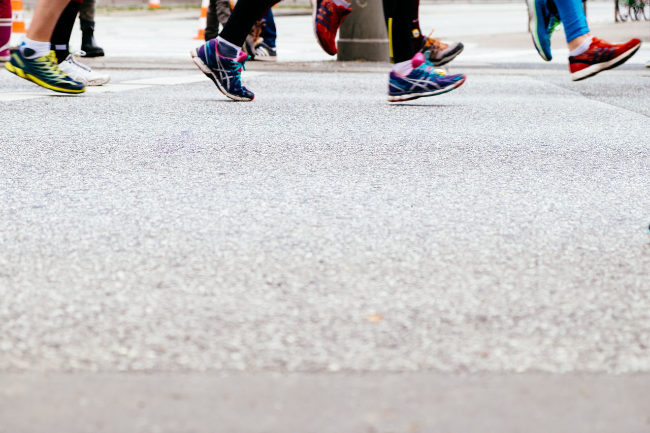 low section, real people, roller skate, human leg, lifestyles, day, leisure activity, road, skill, sport, balance, outdoors, women, human body part, two people, men, adult, people