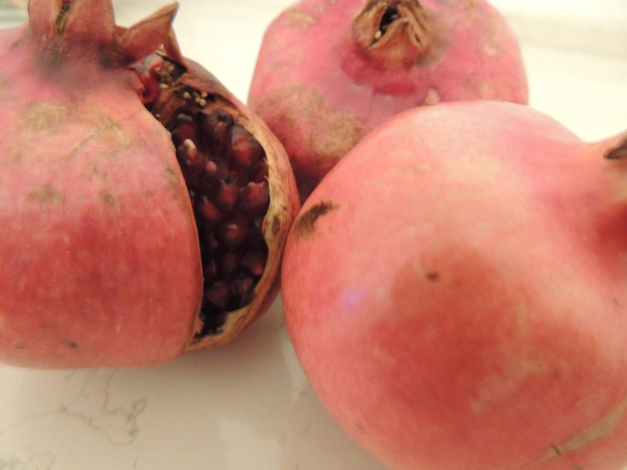 Close-Up Of Pomegranates On Table