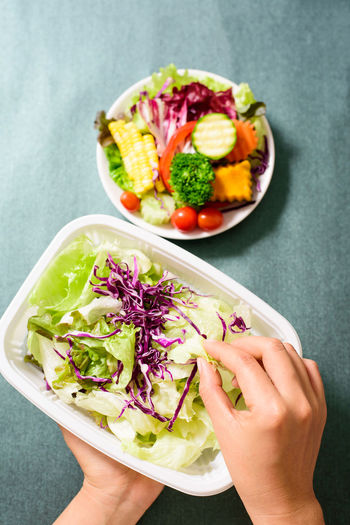 Cooking Cuisine Diet Eating Homemade Meal Vegetarian Food Bowl Food Food And Drink Freshness Gourmet Healthy Eating Healthy Food Healthy Lifestyle High Angle View Holding Human Body Part Human Hand Organic Vegetables Ready-to-eat Salad Vegetable