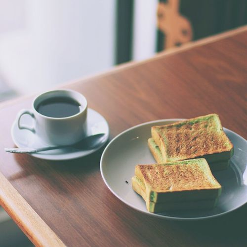 Close-up of black tea and sandwiches on table