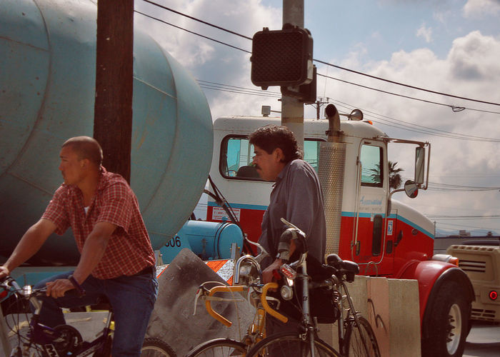 Cloudy Skies Workers Adult Bicycles Casual Clothing Cement Mixer Cement Truck Everyman Laborer Men Mode Of Transport Outdoors People Real People Sky Standing Transportation Two People
