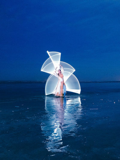 Light painting in the beach against night sky
