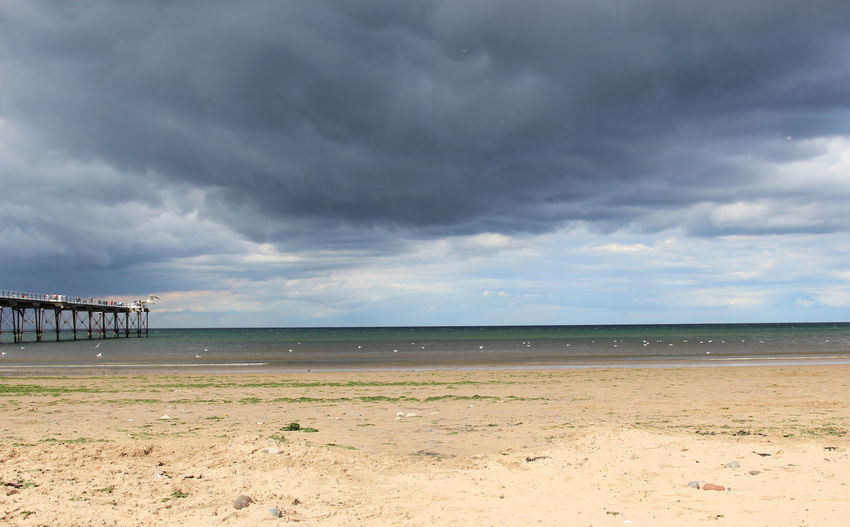 A Storm brewing.... Cloud - Sky Sky Land Beach Water Scenics - Nature Sea Beauty In Nature Nature Horizon Tranquil Scene Tranquility Environment Sand Overcast Horizon Over Water No People Day Non-urban Scene Outdoors