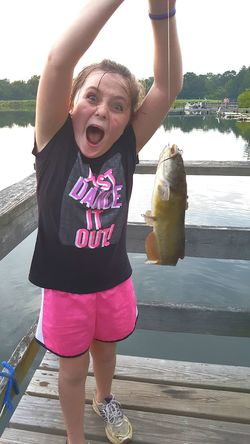 Showing Expression Girl Fishing Fishing Emotions Lake Water One Girl Only Child Mouth Open Childhood Funny Faces Happy Catching Fish Holding Fish Excitement Proud Moment  Nature Lover Catfish Dock Dock On Water Fishing Dock Aquatic Wildlife Catch And Release Outdoor Activity Pet Portraits Inner Power