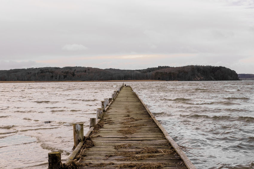 Absence Autumn Boardwalk Cold Horizon Over Water Jetty Lake Leading Narrow Outdoors Perspective Pier Sea The Way Forward Vanishing Point Water Windy Wood Wooden Post