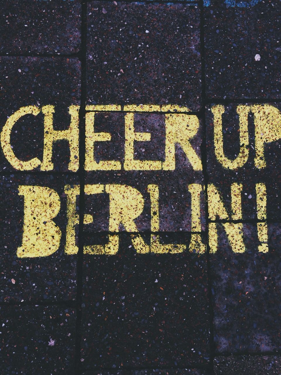 Close-up of text written on footpath