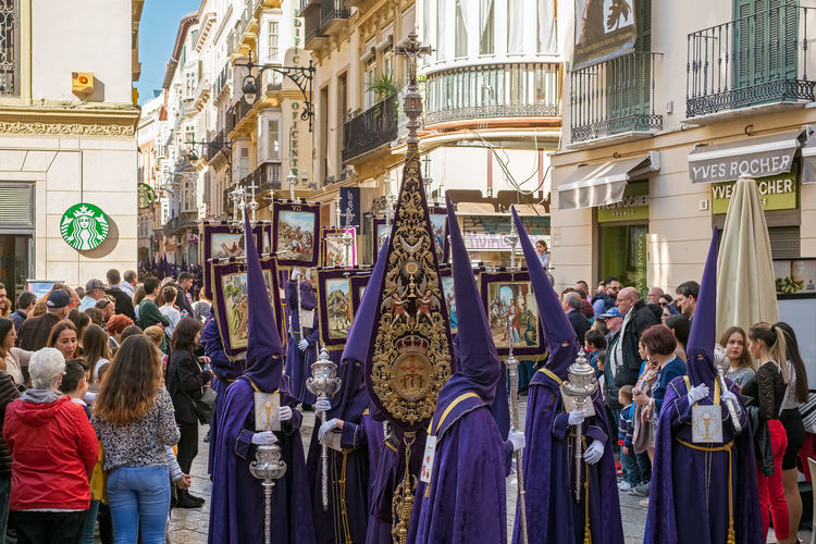 People in the procession in the Holy Week (Semana Santa) in a Spanish city. Malaga, Spain - March 26, 2018. Catolic Church Children Easter Easter Ready Historical Building Holy Week Malaga People Watching SPAIN Semana Santa Spanish Uniform Uniforms Adult Architecture Belief Building Exterior Built Structure Catolicism Celebration City Crowd Day España Group Of People Large Group Of People Lifestyles Men Musical Instrument Musician Musician Bands Old Buildings Old City Outdoors Procession Real People Religion Spain Is Different Spanish Arquitecture Spanish Culture Standing Street Togetherness Women The Street Photographer - 2018 EyeEm Awards The Great Outdoors - 2018 EyeEm Awards