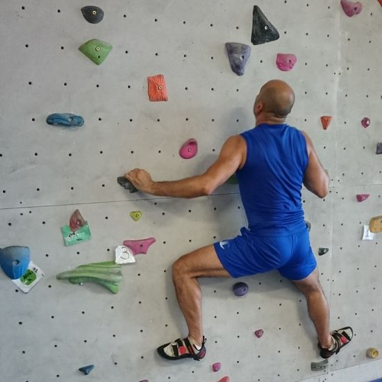 Healthy Lifestyle Sport Exercising Climbing Wall Health Club Gym Adult One Man Only Strength Lifestyles Rock Climbing People Extreme Sports Only Men Adults Only One Person Climbing Physical Activity Full Length Indoors  Spiderman