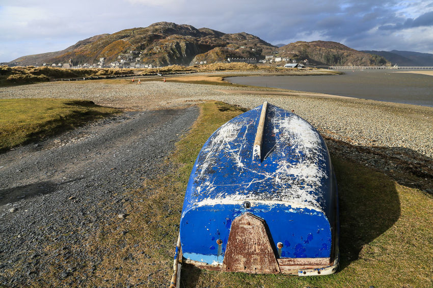 Upturned row boat, Mawddach estuary, looking towards Barmouth, Wales. Beach Beauty In Nature Blue Day Estuary View Mawddach Estuary Mountain Mountain Range Nature No People Outdoors Rowing Boat Scenics Sea Sky Upturned Boat Wales Water