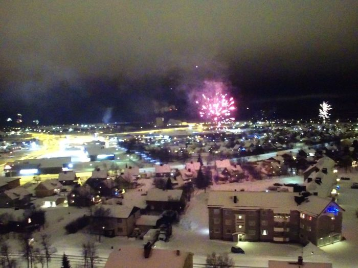 Kiruna, new years evening New Year's Eve Mew Year Sweden Kiruna North Sweden Liselottewajstedt City ©Liselottewajstedt Architecture Built Structure City Building Exterior Cityscape Sky High Angle View Celebration City Life Firework No People Light Street Outdoors Night Building
