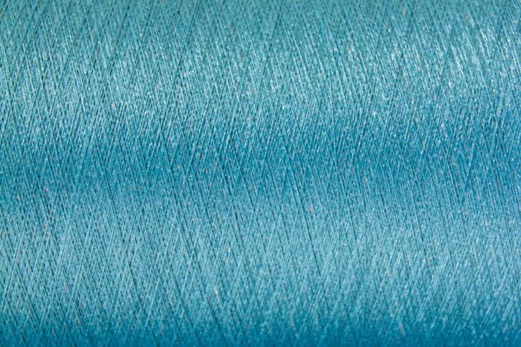 Close-up of blue thread spool