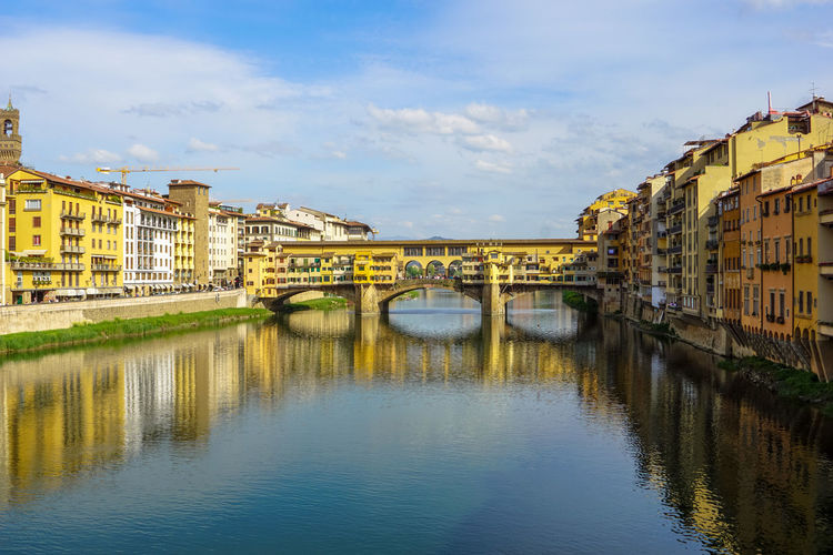 Ponte Vecchio Over Arno River Against Sky In City