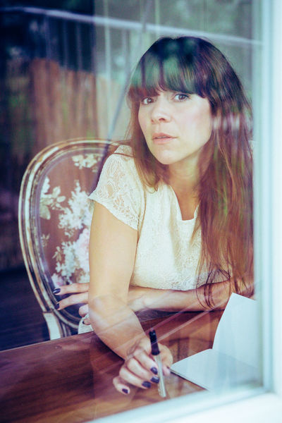 Adult Bangs Beautiful Woman Brown Hair Close-up Day Home Interior Human Hand Indoors  Long Hair Looking At Camera One Person People Portrait Real People Sceptical Sitting Window Young Women