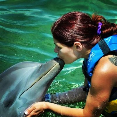 Dolphin loving Dolphin Cancun Beauty