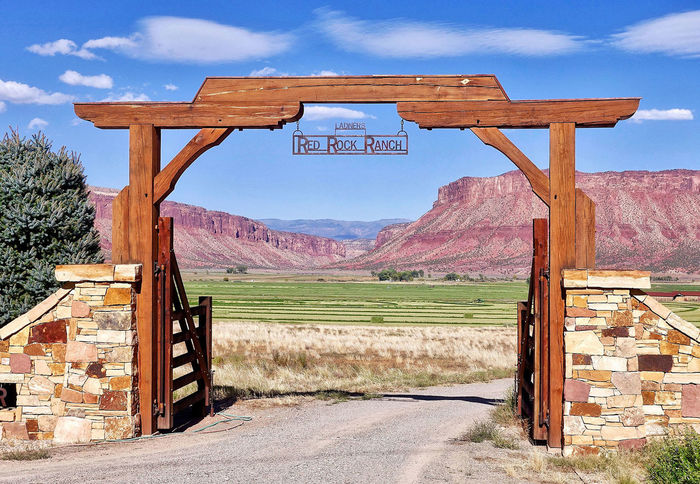 The red rocks at Bedrock in the USA. Colorado Field Gate Ranch USA Beauty In Nature Bedroom Clouds Day Landscape Mountain Range Mountains Nature No People Outdoors Red Rocks  Road Scenics Sky Text Tranquility Tree Wood - Material