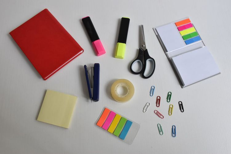 Multi Colored Pen Variation Indoors  Choice Large Group Of Objects Studio Shot No People High Angle View Scissors Table Still Life Writing Instrument Office Arrangement Paper Stapler Clip Postit Office Supply Tape Colorful Notebook