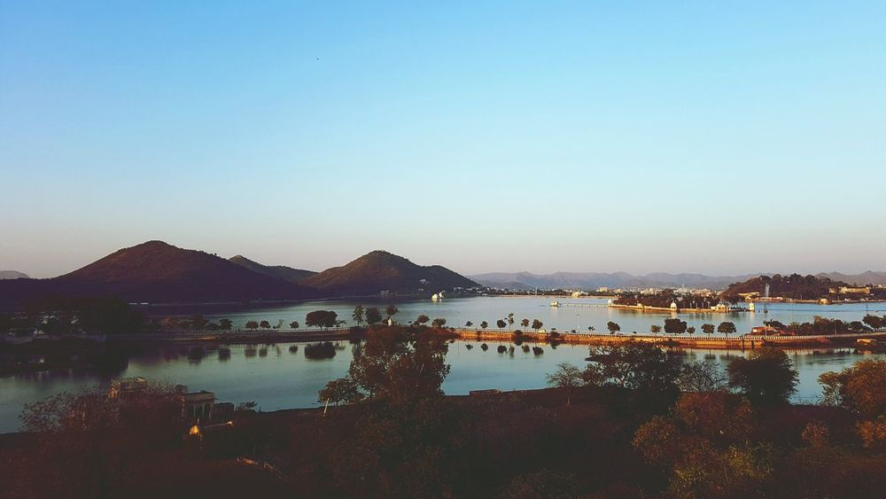 Water Mountain Outdoors Lake Clear Sky Reflection Sky No People Day Blue Nature Sunset Scenics Beauty In Nature Udaipur. India