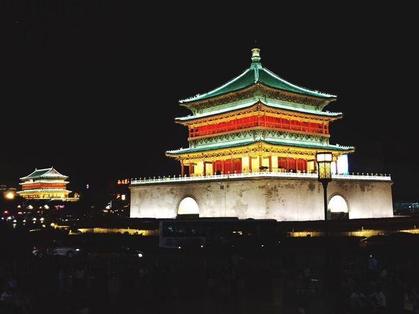 Xi'an clock tower by night. Clock Tower Architecture Building Exterior Night Illuminated Outdoors Sky
