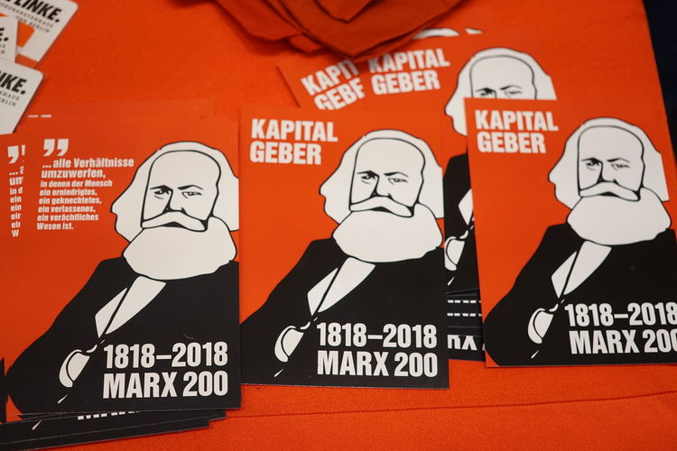 Postcards commemorating Marx's 200th birthday and the 150th anniversary of Marx's Capital with the text 'Kapitalgeber (capital investors) 5. Mai 2018 Marx 200' Marxism Anniversary Capitalism Close-up Commemorate Commemorative Communication Information Karl Marx No People Socialism Text
