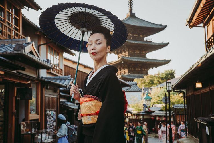Woman standing against buildings