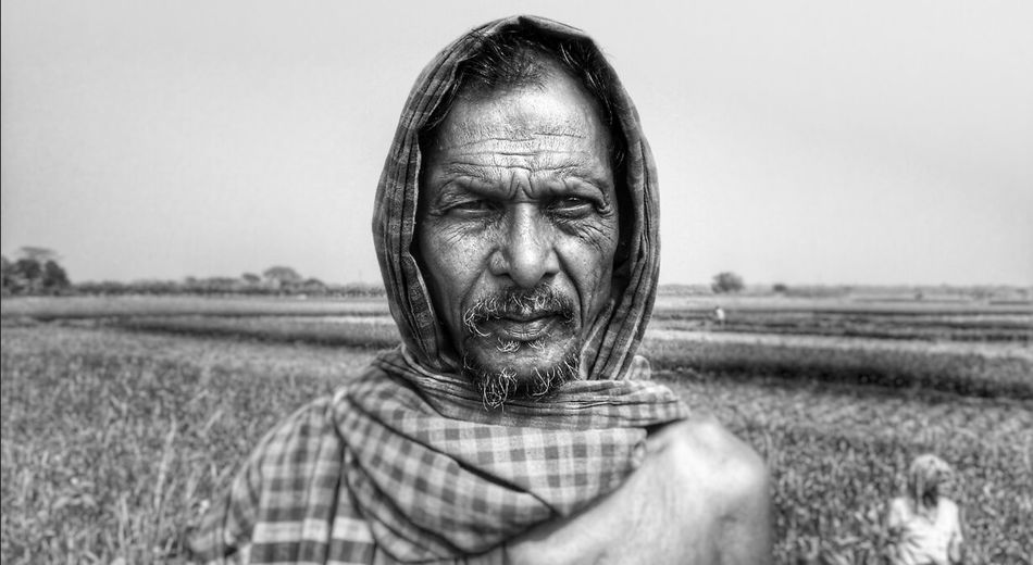 I tried to capture the simple expression of this man. Look at his eyes there is no complexities, no ego, no cruelty, no racism, no extremism, no cleverness, no cheating attitude. .... only thing you find is hunger... how to live.. how to collect food for him and his family... This is the Story Of The Marginalised People irrespective of all the countries and people. Simple Expression Deceptively Simple Portrait Black & White B & W Protrait People And Culture My Country My People Faces Of Summer From My Point Of View People Photography Monochrome EyeEm Outdoors EyeEm Gallery Getty Images Everybodystreet EyeEm Best Shots Eyeem Best Image Eyeem Best Click Eyeem4photography Snapshots Of Life People Street Photography Showcase: February The Portraitist - 2018 EyeEm Awards The Photojournalist - 2018 EyeEm Awards