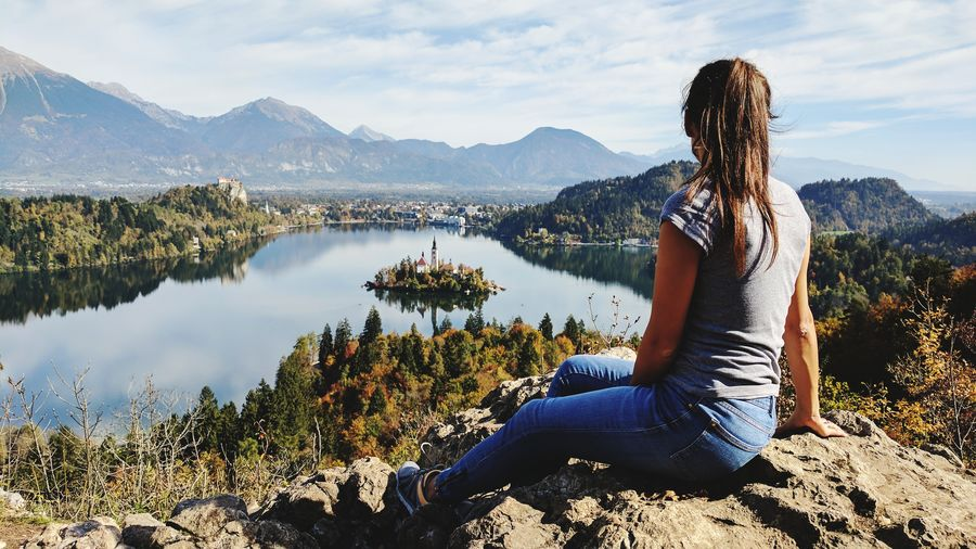 Only Women One Woman Only One Person Adults Only Sitting Adult Lake Women Mountain Relaxation Leisure Activity People Yoga Weekend Activities Nature Water Vacations Outdoors Day Lifestyles Rear View Slovenia Human Back Bled Perspectives On Nature