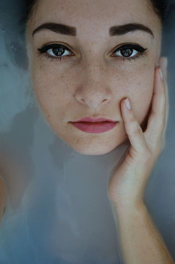 Close-Up Portrait Of Woman In Bathtub