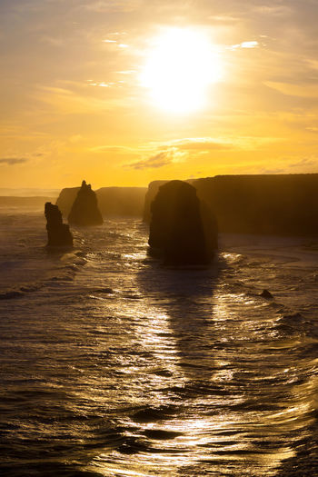 Scenic view of the twelve apostles against sky during sunset