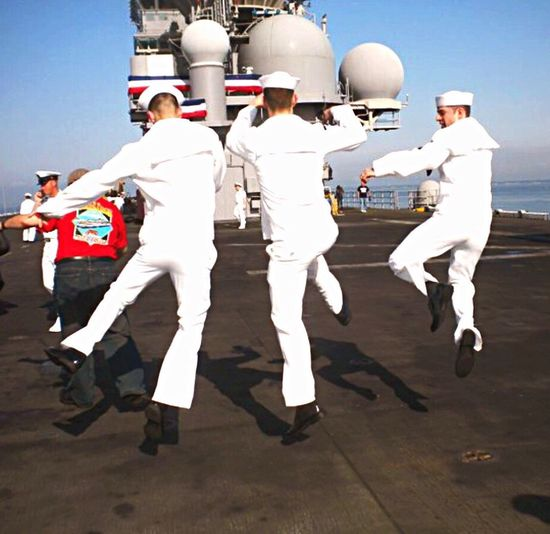 Navy Sailors come home from deployment Navy Navy Ship Happy Jump For Joy Jumping Uniforms Sky Blue