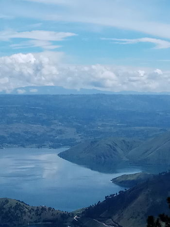 Holidays in Samosir Aerial View Beauty In Nature Blue Cloud - Sky Day High Angle View Landscape Mountain Nature No People Outdoors Scenics - Nature Sky Tranquil Scene View Into Land Water