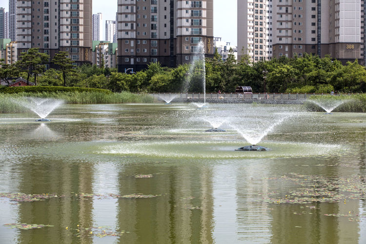 Architecture Building Building Exterior Built Structure Capital Cities  City City Life Cityscape Day Fountain Fountain Growth Michuhol Park Modern Motion Nature No People Office Building Outdoors Reflection Rippled Songdo, Incheon Travel Destinations Water Waterfront