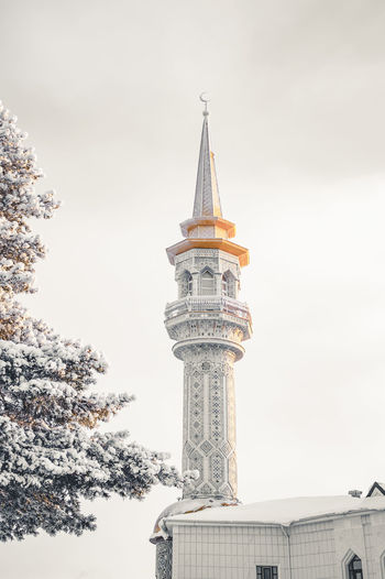 Low angle view of mosque  against sky. minaret.