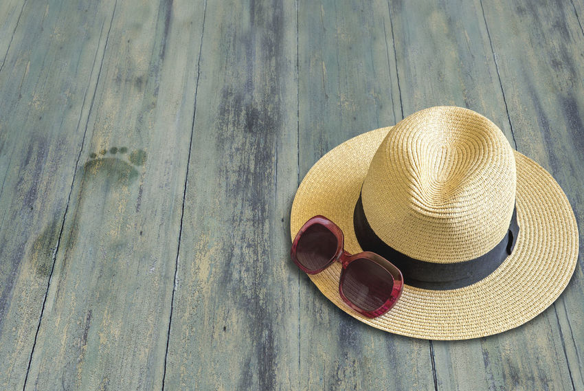 Holidays, woman accessories on a wooden floor Farniente FootPrint Hat Holiday Holidays Vacations Background Hat High Angle View No People Rest Straw Hat Summer Sun Hat Sunglasses Warm Woman Accessories Wood - Material
