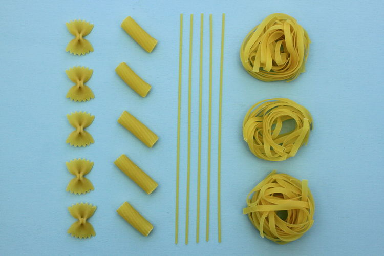 Knolling Background Blue Directly Above Farfalle Italian Food Knolling - Concept Macaroni Parallel Pasta Style
