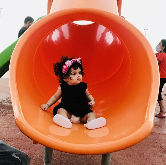 Cute girl playing in playground